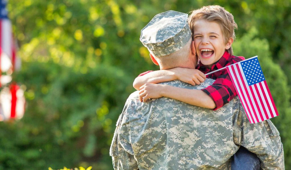 child hugging veteran